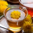 Dandelion tea and honey with yellow blossoms on wooden table, — Stock Photo #71252047