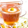 Herbal tea of chamomile with fresh blossom and honey on white background — Stock Photo #76642337