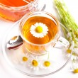 Chamomile tea with blossoms and honey on white background — Stock Photo #76642387