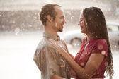 Couple in love under rain — Stock Photo