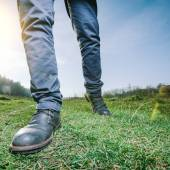 Man walking on meadow — Stock Photo