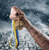 Hand holding medal — Stock Photo