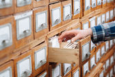 Male hand with file cabinet drawer — Stock Photo
