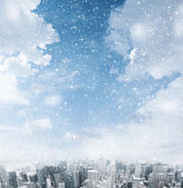 White clouds over cityscape — Stock Photo