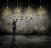 Businessman posing over sketches — Stock Photo