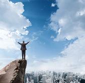Businessman on mountain top — Stock Photo