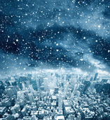 Cityscape with snowy sky — Stock Photo
