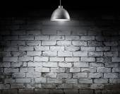 Brick wall and ceiling lamp — Stock Photo