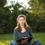 Girl reading holy Bible — Stock Photo #61118271