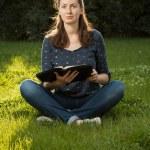 Girl reading holy Bible — Stock Photo #61118297