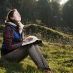 Girl reading holy Bible — Stock Photo #61118617