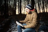 Man reading Bible in park — Stock Photo