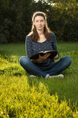 Girl reading holy Bible — Foto Stock