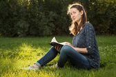 Girl reading holy Bible — Stock Photo