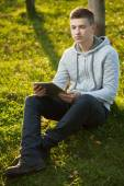 Boy with tablet pc at park — Stock Photo