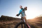 Woman riding mountain bike — Stock Photo