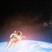 Astronaut spaceman in space — Stock Photo