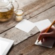 Girl writing on a sheet of paper — Stock Photo #72324853