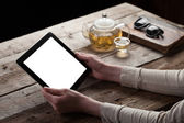 Woman shows screen of digital tablet — Stock Photo