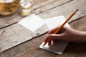 Woman wring on sheet of paper — Stock Photo