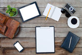 Blank paper with Black tablet computer ipad style and smart phone around — Stock Photo