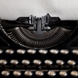 Typewriter with aged textured paper sheet — Stock Photo #81125950