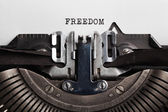 Typewriter with paper sheet. freedom concept — Stock Photo
