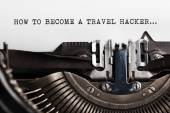 Become a Travel Hacker sign with typewriter — Stock Photo