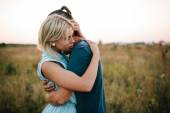 Couple hugging outdoor in the field, summertime — Stock Photo