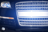 Xenon light reflection of a front grille of car — Stock Photo