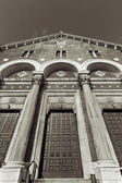 Tall church entrance with arcs and columns — Stock Photo