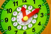 Wooden green clock with red arrows closeup — Stock Photo