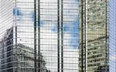 Building reflections on glass and steel side of a tower — Stock Photo
