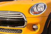 New orange car bumper and grille closeup — Stock Photo