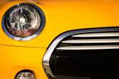 Front grille of yellow sport car — Stock Photo