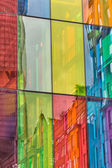 Urban reflections on colored windows of Convention Center Montre — Stock Photo