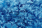 Frost patterns on house glass macro — Stock Photo