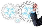 Human resources spinning gear box wheels — Stock Photo