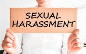 Sexual harassment text on cardboard — Stock Photo
