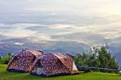 Camping tent at valley in the morning with mist. — Stock Photo