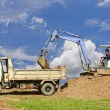 Backhoe loading a dump truck. — Stock Photo #52667987