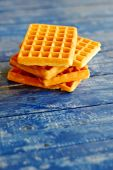 Belgian waffles on wooden table — Stock Photo
