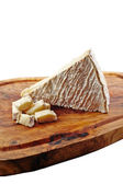 Brie cheese on wooden slate — Foto Stock