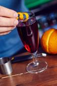 Red alcohol cocktail with orange slice — Stock Photo