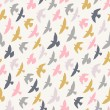 Seamless pattern of flying birds. Pastel background. — Stock Vector #63817853
