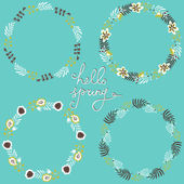 Set of floral frame. Beautiful collection of wreaths made of hand drawn leaves and flowers. Blue backdrop. — Stock Vector