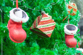 Red boots and Gifts Ornament on Christmas Tree — Stok fotoğraf