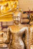 Gild ancient buddha statue in a Thai temple — Stock Photo