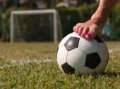 Soccer ball in a green field near a five-a-side goal, outdoor — Stock Photo