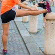 Girl stretching before running in city marathon — Stock Photo #54441713